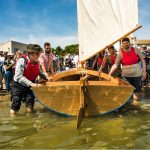 Launch Day - Class of August 2016 The beautiful Oak transom glistening in the sun as its backed into the water for the first time