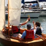 Launch Day - Class of August 2016 15′ 'Jessie' a Paul Gartside Design and the students who built her popping champagne as it sails through the harbour
