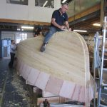 The yellow cedar strip planking completed on the 20' Paul Gartside Outboard Launch