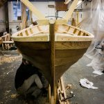 16' Smakke Jolle having the second coat of Pine tar applied
