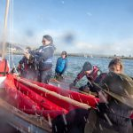 Class of February 2016 - Thomasin Sage popping a bottle of champagne on the Christmas Wherry
