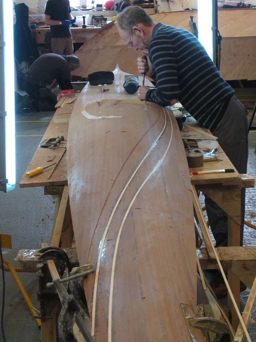 Student Duncan Riddle works on his Sea Kayak in preperation for the boatlaunch and exhibiting at London Craft Week